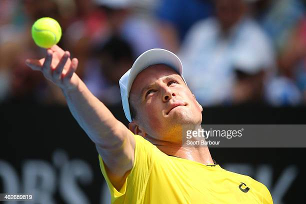 Kenny De Schepper of France serves in his second round match against Tomas Berdych of the Czech Republic during day three of the 2014 Australian Open...