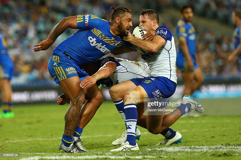 Kenny Edwards of the Eels is tackled by Josh Reynolds of the Bulldogs during the round nine NRL match between the Parramatta Eels and the Canterbury Bulldogs at ANZ Stadium on April 29, 2016 in Sydney, Australia.