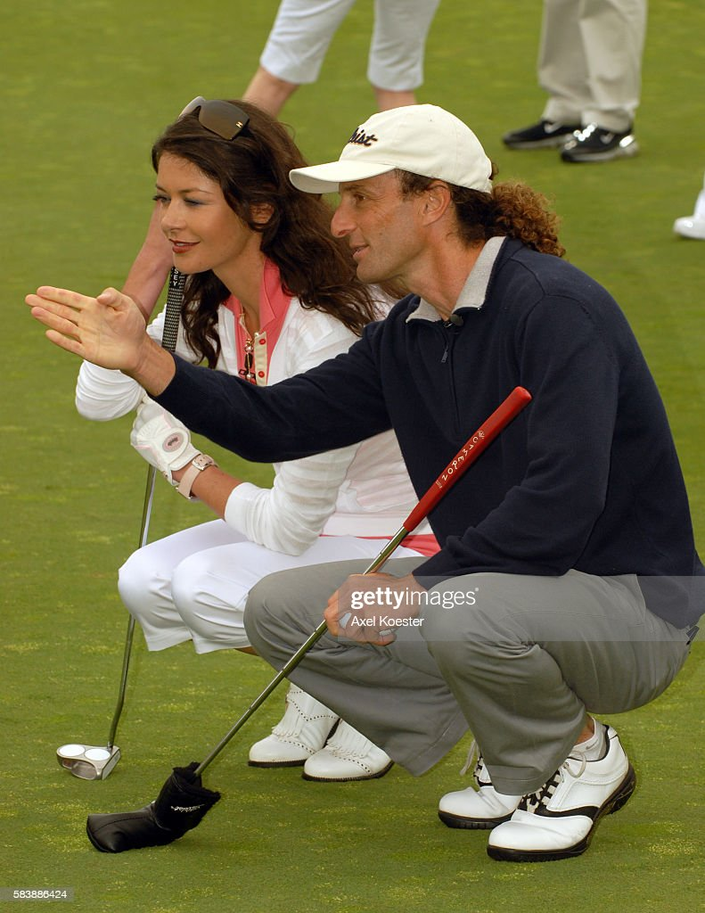Kenny G and actress Catherine ZeaJones play in the Ninth Annual Michael Douglas Friends Celebrity Golf Tournament at the Trump National Golf Club in...