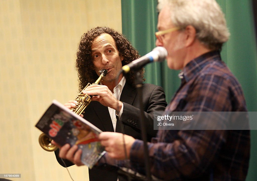 <a gi-track='captionPersonalityLinkClicked' href=/galleries/search?phrase=Kenny+G&family=editorial&specificpeople=211357 ng-click='$event.stopPropagation()'>Kenny G</a> (L) and Jim Cummings perform during a live Interactive reading event of 'ELFBOT' inside Barnes & Noble at The Americana at Brand on December 7, 2012 in Glendale, California.