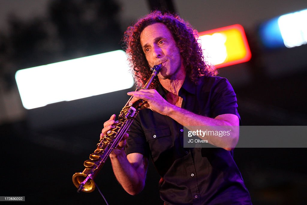 <a gi-track='captionPersonalityLinkClicked' href=/galleries/search?phrase=Kenny+G&family=editorial&specificpeople=211357 ng-click='$event.stopPropagation()'>Kenny G</a> performs on stage during Americafest 2013, 87th Annual Fourth of July Celebration at Rose Bowl on July 4, 2013 in Pasadena, California.