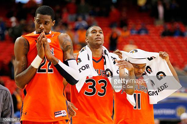 Kenny Gabriel Earnest Ross and Josh Wallace of the Auburn Tigers react after loosing to the Georgia Bulldogs 51 to 69 during the first round of the...