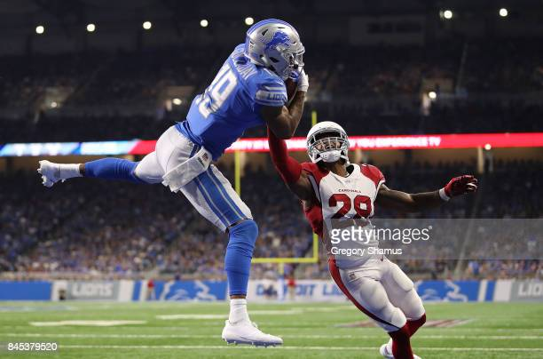 Kenny Golladay of the Detroit Lions catches a fourth quarter touchdown next to Justin Bethel of the Arizona Cardinals at Ford Field on September 10...