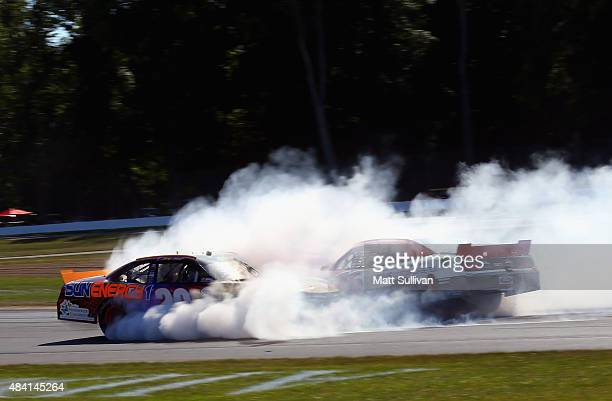 Kenny Habul driver of the SunEnergy 1 Toyota and Ryan Reed driver of the Lilly/American Diabets Association Ford crash during the Nationwide...