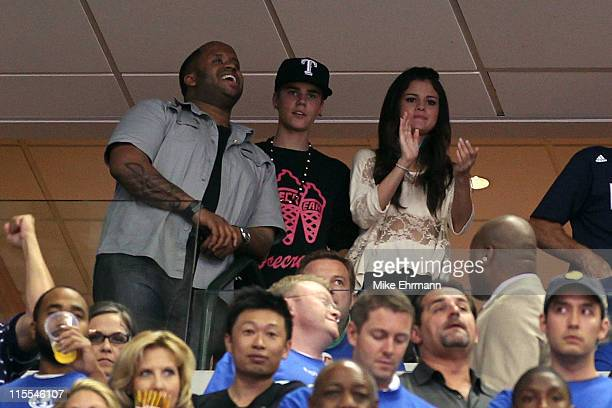 Kenny Hamilton and Singers Justin Bieber and Selena Gomez attend Game Four of the 2011 NBA Finals between the Dallas Mavericks and the Miami Heat at...