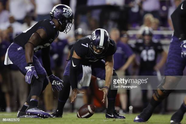 Kenny Hill of the TCU Horned Frogs fumbles the snap against the Kansas Jayhawks in the first quarter at Amon G Carter Stadium on October 21 2017 in...