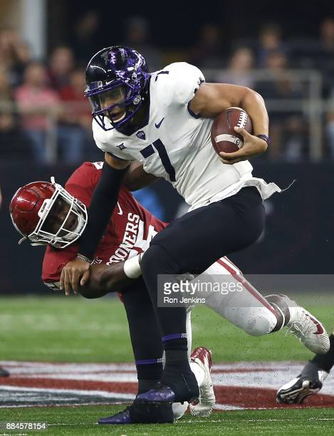 Kenny Hill of the TCU Horned Frogs is sacked by Kenneth Mann of the Oklahoma Sooners in the second half of the Big 12 Championship ATT Stadium on...