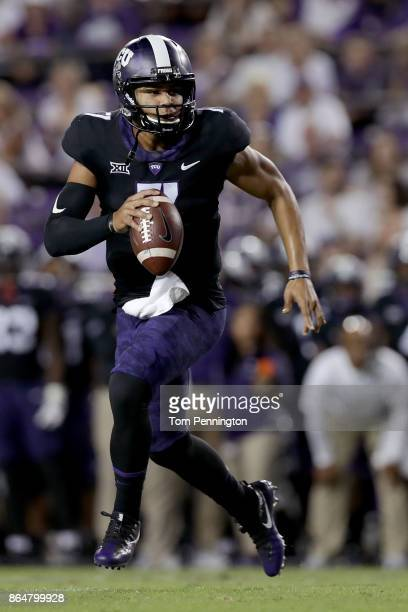 Kenny Hill of the TCU Horned Frogs rolls out and throws a touchdown pass against the Kansas Jayhawks in the first quarter at Amon G Carter Stadium on...