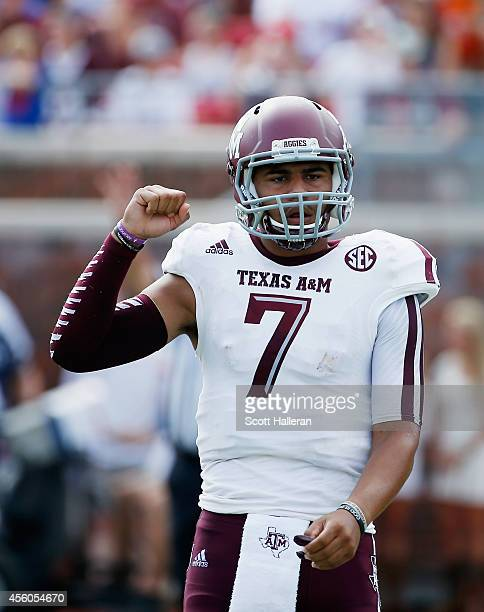 Kenny Hill of the Texas AM Aggies celebrates a touchdown during the first half of their game against the Southern Methodist Mustangs at the Gerald J...