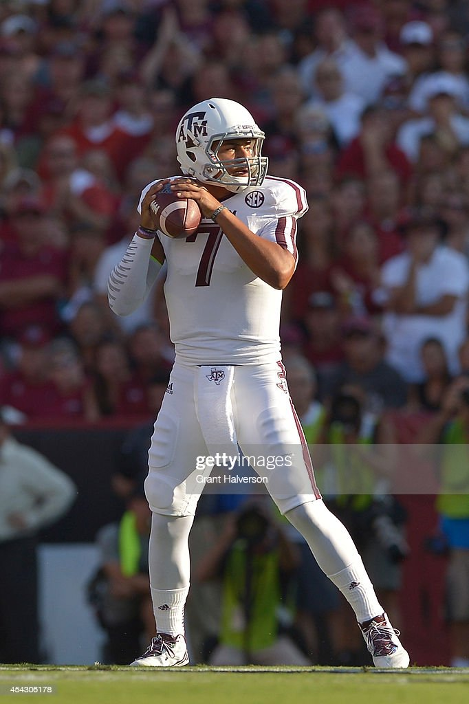 Kenny Hill #7 of the Texas A&M Aggies drops back to pass South Carolina Gamecocks during their game at Williams-Brice Stadium on August 28, 2014 in Columbia, South Carolina.
