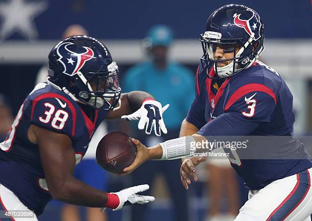 Kenny Hilliard and Tom Savage of the Houston Texans during a preseason game on September 3 2015 in Arlington Texas