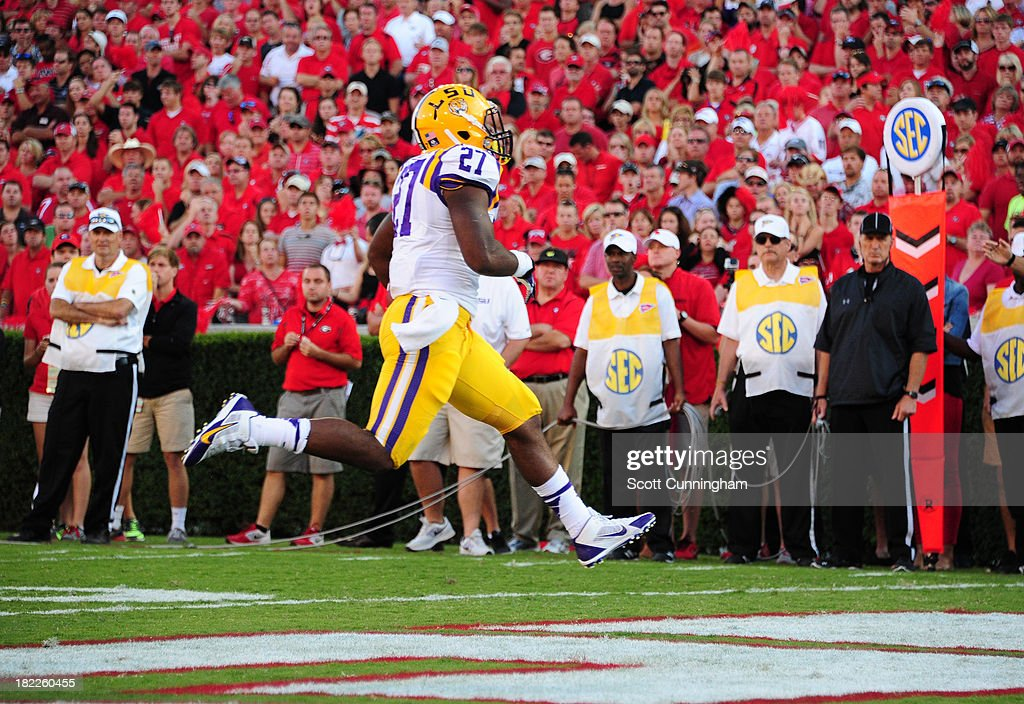Kenny Hilliard #27 of the LSU Tigers carries the ball for a touchdown against the Georgia Bulldogs at Sanford Stadium on September 28, 2013 in Athens, Georgia.