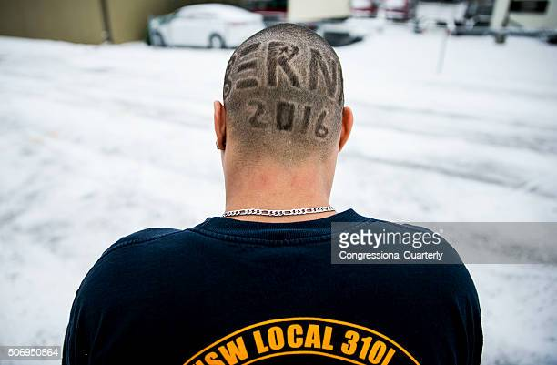 STATES JANUARY 26 Kenny Jackson from Knoxville Iowa smoke a cigarette as he dons a shaved head in support of Democratic presidential candidate Sen...