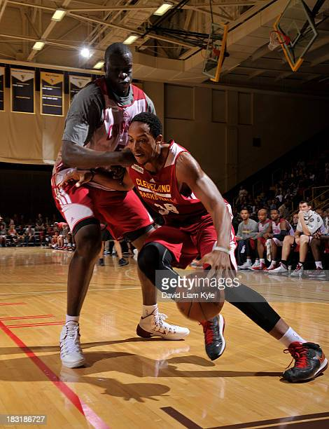Kenny Kadji of the Cleveland Cavaliers drives to the hoop against DeSagana Diop of the Cleveland Cavaliers during their annual Wine Gold Scrimmage at...
