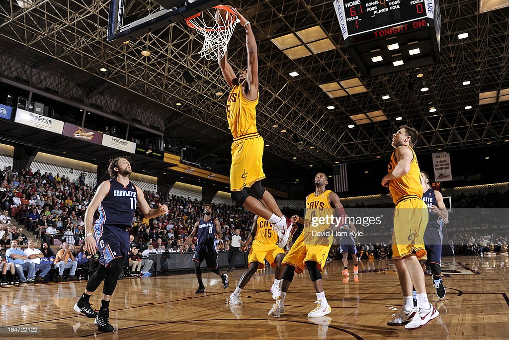 <a gi-track='captionPersonalityLinkClicked' href=/galleries/search?phrase=Kenny+Kadji&family=editorial&specificpeople=5759678 ng-click='$event.stopPropagation()'>Kenny Kadji</a> #35 of the Cleveland Cavaliers dunks the ball against the Charlotte Bobcats at the Canton Memorial Civic Center on October 15, 2013 in Canton, Ohio.