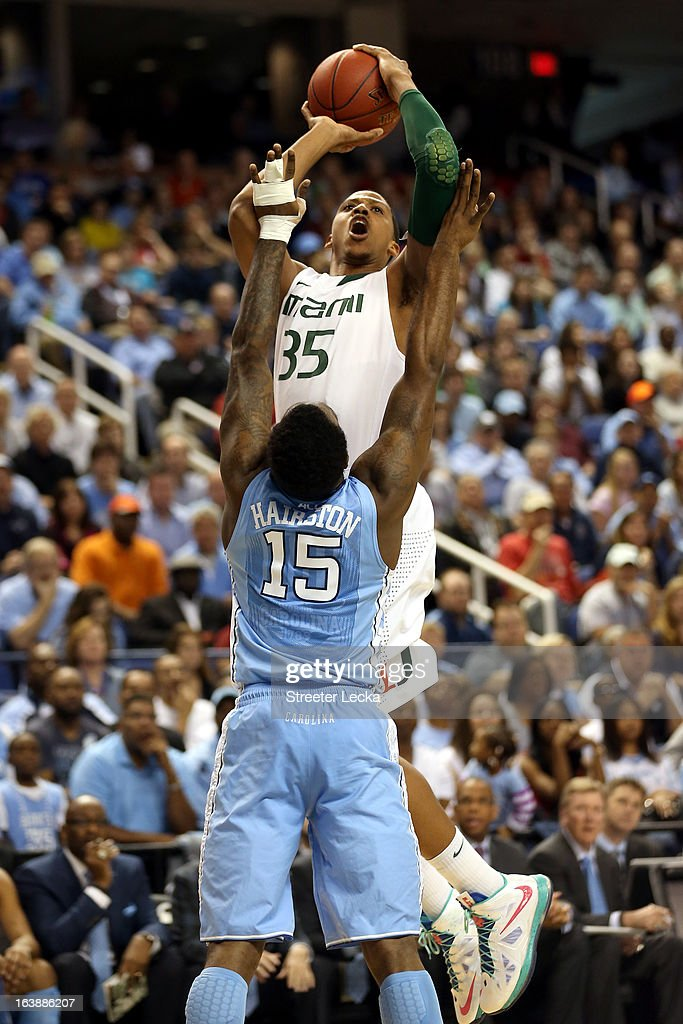 Kenny Kadji #35 of the Miami (Fl) Hurricanes attempts a shot in the first half against the P.J. Hairston #15 of the North Carolina Tar Heels during the final of the Men's ACC Basketball Tournament at Greensboro Coliseum on March 17, 2013 in Greensboro, North Carolina.