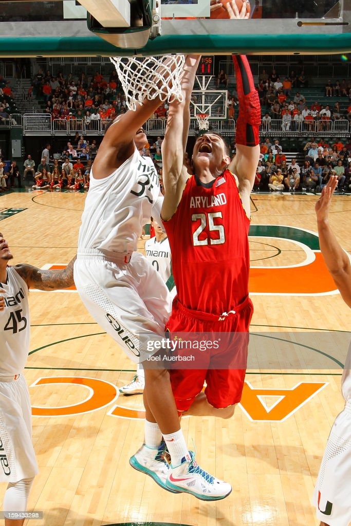 Kenny Kadji #35 of the Miami Hurricanes blocks the shot by Alex Len #25 of the Maryland Terrapins on January 13, 2013 at the BankUnited Center in Coral Gables, Florida. Miami defeated Maryland 54-47.
