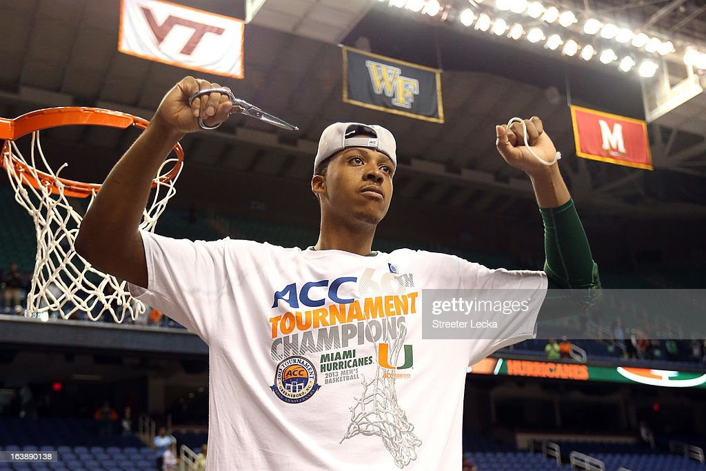 Kenny Kadji #35 of the Miami (Fl) Hurricanes celebrates after he cut down a piece of the net after they won 87-77 against the North Carolina Tar Heels during the final of the Men's ACC Basketball Tournament at Greensboro Coliseum on March 17, 2013 in Greensboro, North Carolina.