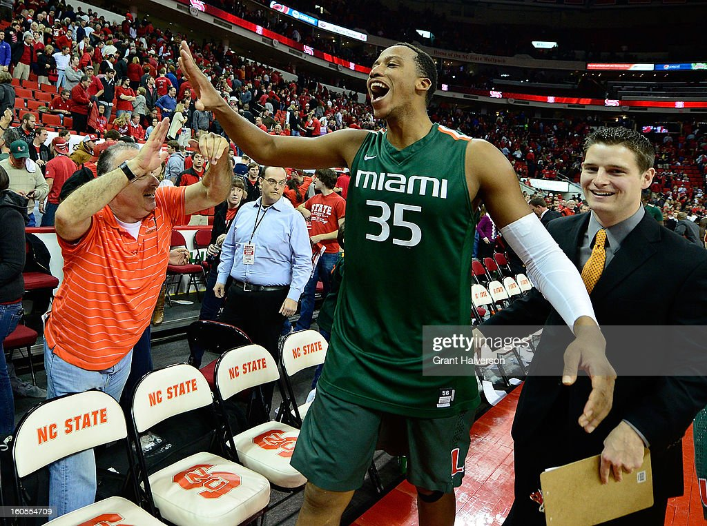 Kenny Kadji #35 of the Miami Hurricanes celebrates with fans after a last-second win over the North Carolina State Wolfpack at PNC Arena on February 2, 2013 in Raleigh, North Carolina. Miami won 79-78.