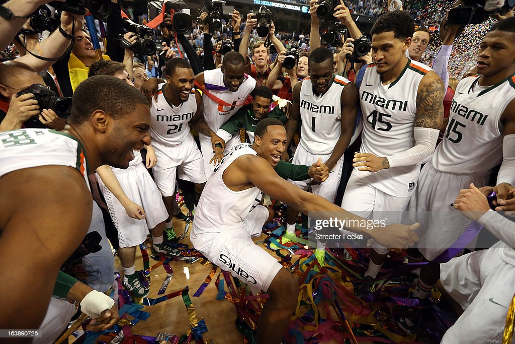 Kenny Kadji #35 (C) of the Miami (Fl) Hurricanes celebrates with teammates after they won 87-77 against the North Carolina Tar Heels during the final of the Men's ACC Basketball Tournament at Greensboro Coliseum on March 17, 2013 in Greensboro, North Carolina.