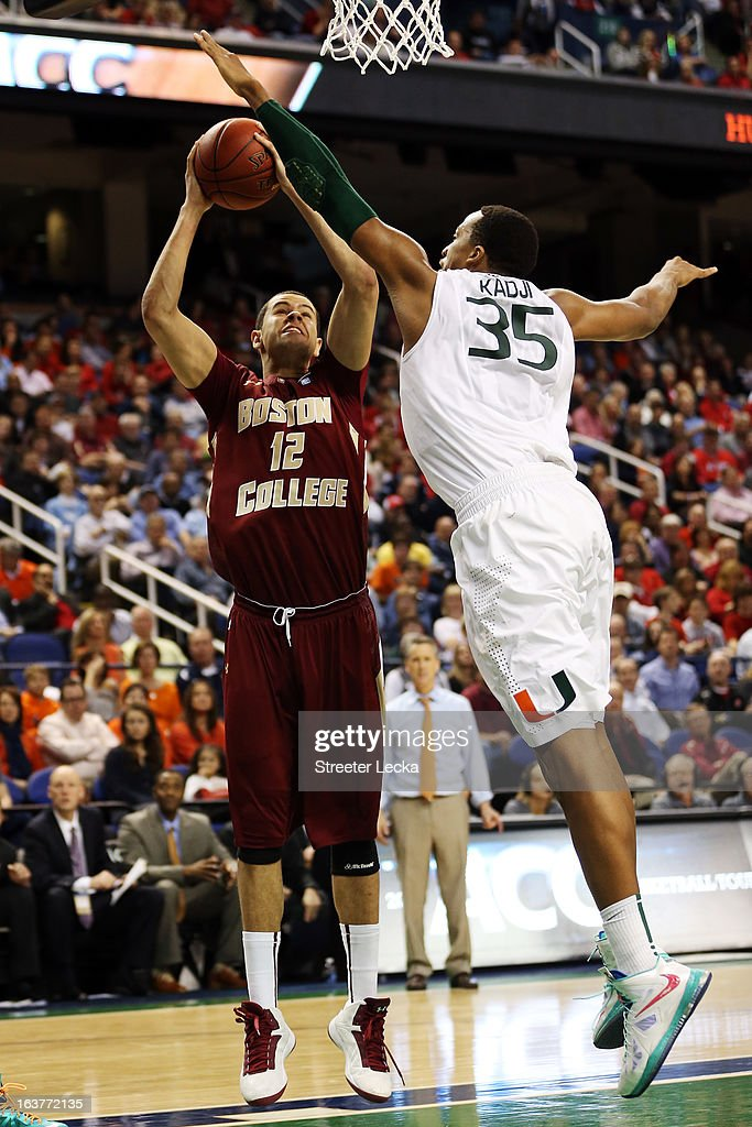 Kenny Kadji #35 of the Miami Hurricanes goes for the block against Ryan Anderson #12 of the Boston College Eagles during the quarterfinals of the ACC Men's Basketball Tournament at the Greensboro Coliseum on March 15, 2013 in Greensboro, North Carolina.