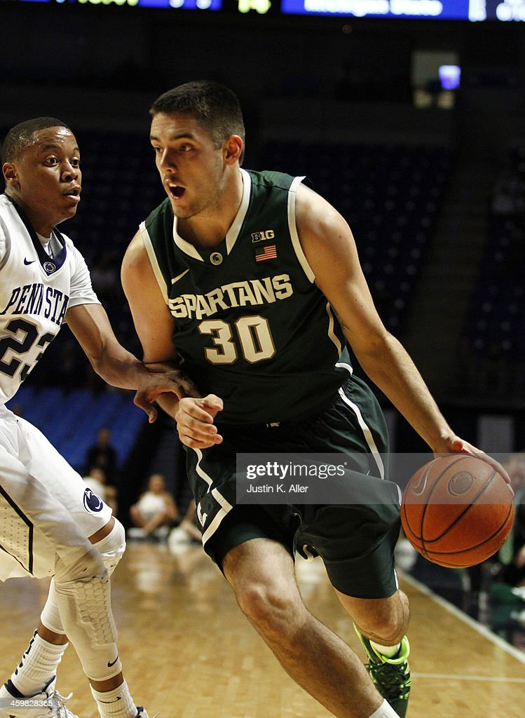 Kenny Kaminski #30 of the Michigan State Spartans drives against the Penn State Nittany Lions at the Bryce Jordan Center on December 31, 2013 in State College, Pennsylvania.
