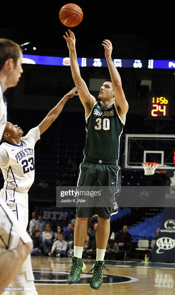 Kenny Kaminski #30 of the Michigan State Spartans pulls up for a three-point shot against the Penn State Nittany Lions at the Bryce Jordan Center on December 31, 2013 in State College, Pennsylvania.