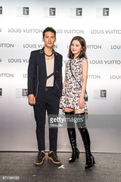Kenny Kwan and Charlene Choi pose at the red carpet during the opening night of the Time Capsule Exhibition by Louis Vuitton on 21 April 2017 in Hong...