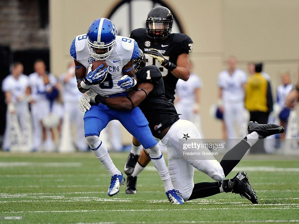 Kenny Ladler #1 of the Vanderbilt Commodores tackles Demarco Robinson #9 of the Kentucky Wildcats at Vanderbilt Stadium on November 16, 2013 in Nashville, Tennessee.
