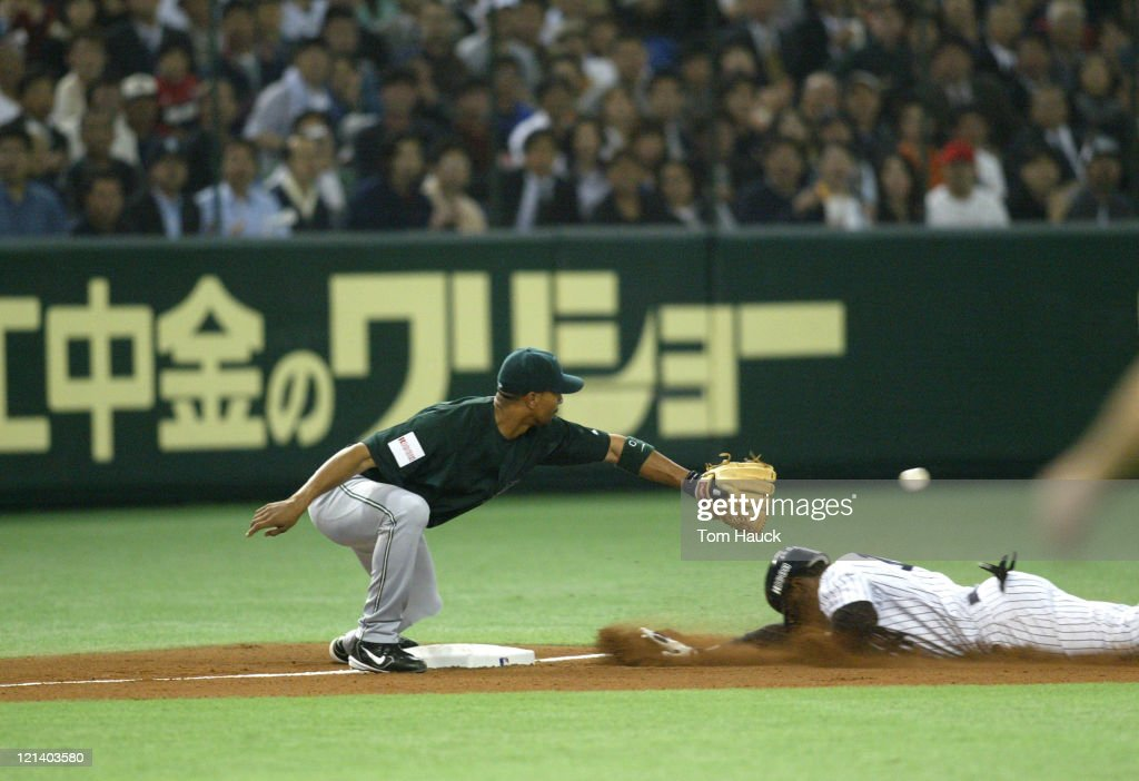 Kenny Lofton #12 of the New York Yankees is safe on a second inning triple.MLB Opening Day the New York Yankees are defeated by the Tampa Bay Devil Rays 8-3 at the Tokyo Dome in Tokyo, Japan.
