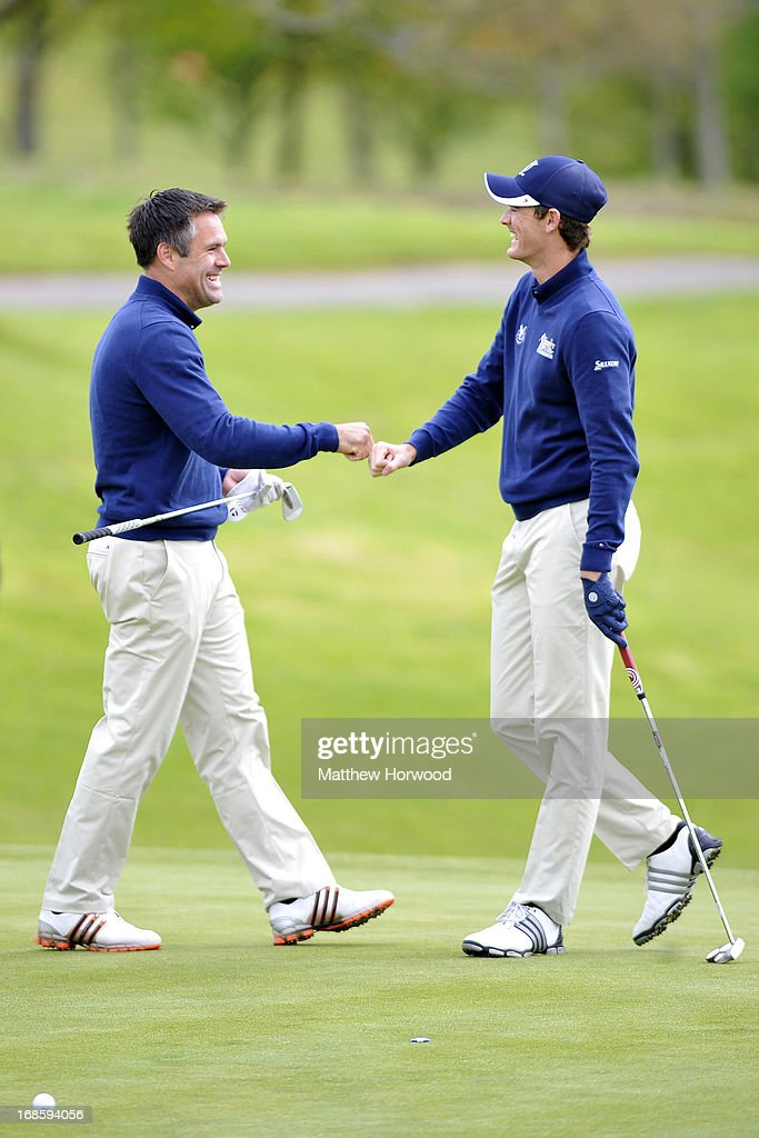 Kenny Logan (L) and Jamie Murray (R) celebrate after winning a hole at the Celebrity Golf Club Live event at Celtic Manor Resort on May 12, 2013 in Newport, Wales.