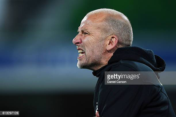 Kenny Lowe coach of the Perth Glory shouts instructions during the round one ALeague match between the Perth Glory and the Central Coast Mariners at...