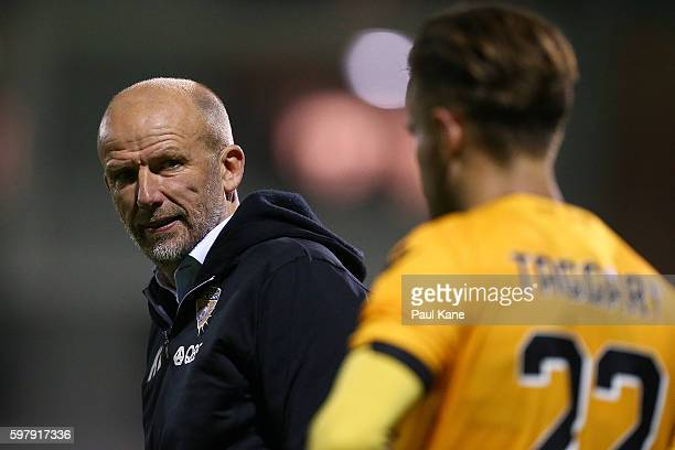 Kenny Lowe head coach of the Glory talks with Adam Taggart of the Glory during the round 16 FFA Cup match between Perth Glory and Sydney FC at...