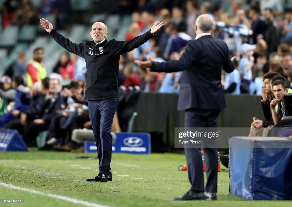 Kenny Lowe, manager of the Glory, has words with Graham Arnold, coach of of Sydney FC after a video referee decision during the A-League Semi Final match between Sydney FC and the Perth Glory at Allianz Stadium on April 29, 2017 in Sydney, Australia.