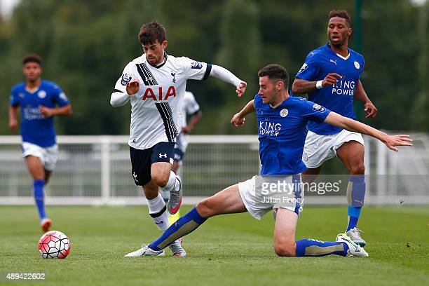 Kenny McEvoy of Spurs is tackled by Elliott Moore of Leicester City during the Barclays U21 Premier League match between Tottenham Hotspur U21 and...