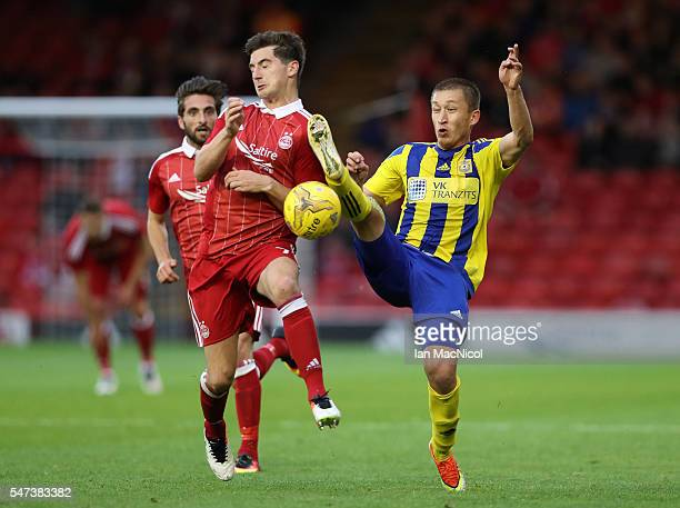 Kenny McLean of Aberdeen vies with Vitalijs Recickis of Ventspils during the UEFA Europa league second qualifying round first leg match between...