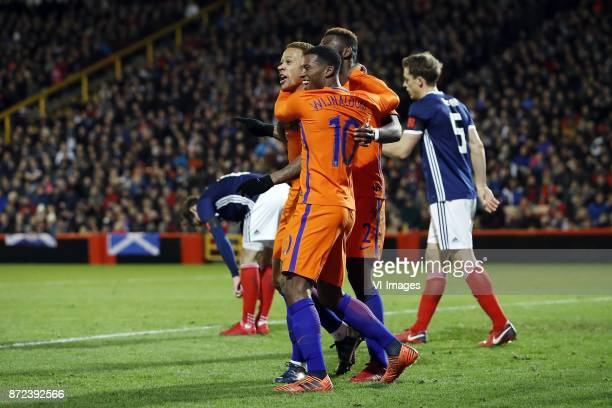 Kenny McLean of Scotland Memphis Depay of Holland Georginio Wijnaldum of Holland Timothy FosuMensah of Holland Christophe Berra of Scotland during...