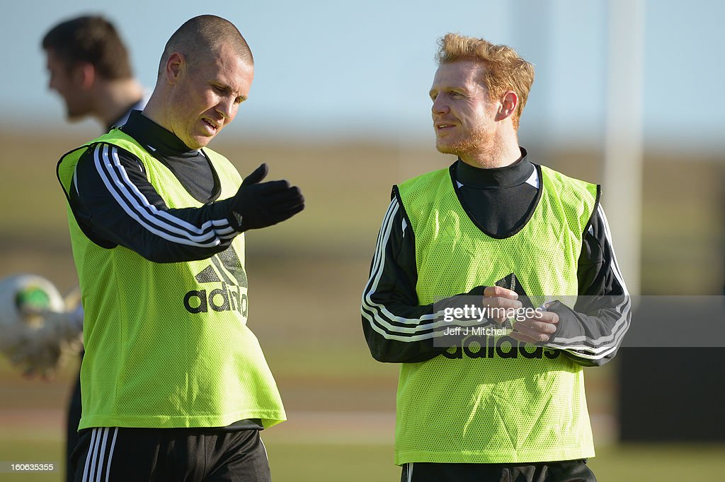 Kenny Miller and Kris Burke react during Gordon Strachan's first training session as Scotland coach at the Aberdeen Sports village on February 4, 2013 in Aberdeen, Scotland. Gordan Strachan will have his first game in charge against Estonia in an international friendly at Pittodrie on Wednesday.