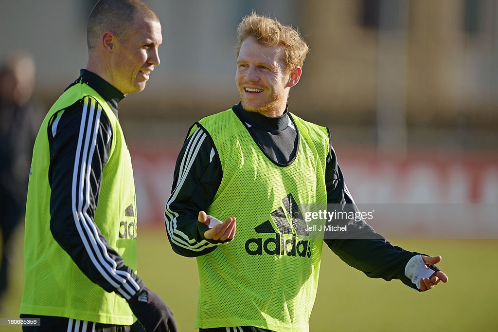 <a gi-track='captionPersonalityLinkClicked' href=/galleries/search?phrase=Kenny+Miller&family=editorial&specificpeople=213276 ng-click='$event.stopPropagation()'>Kenny Miller</a> and Kris Burke react during Gordon Strachan's first training session as Scotland coach at the Aberdeen Sports village on February 4, 2013 in Aberdeen, Scotland. Gordan Strachan will have his first game in charge against Estonia in an international friendly at Pittodrie on Wednesday.