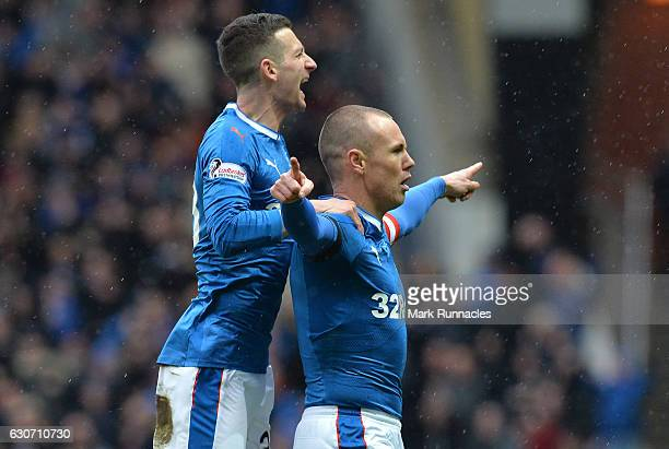 Kenny Miller of Rangers celebrates scoring the opening goal with his team mate Jason Holt during the Ladbrokes Scottish Premiership match between...