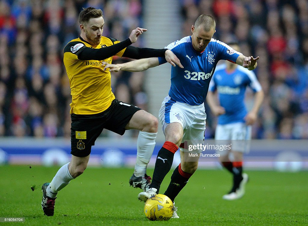 Kenny Miller of Rangers is tackled by Jon Routledge of Dumbarton during the Scottish Championship match between Glasgow Rangers FC and Dumbarton FC...