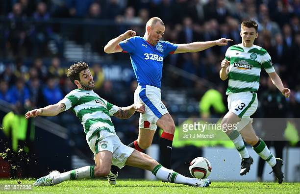 Kenny Miller of Rangers is tackled by Nir Bitton of Celtic during the William Hill Scottish Cup semi final between Rangers and Celtic at Hampden Park...