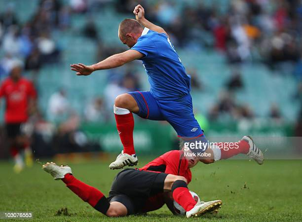 Kenny Miller of Rangers is tackled during the preseason friendly match between Blackburn Rovers and Glasgow Rangers at the Sydney Football Stadium on...