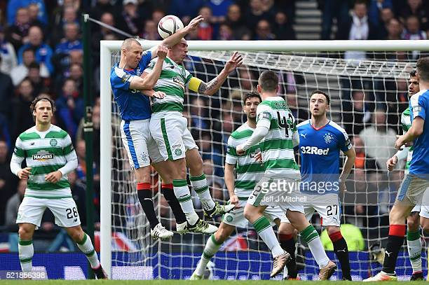 Kenny Miller of Rangers jumps for the ball with Scott Brown of Celtic during the William Hill Scottish Cup semi final between Rangers and Celtic at...