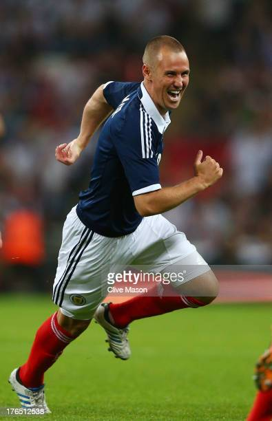 Kenny Miller of Scotland celebrates after scoring a goal during the International Friendly match between England and Scotland at Wembley Stadium on...
