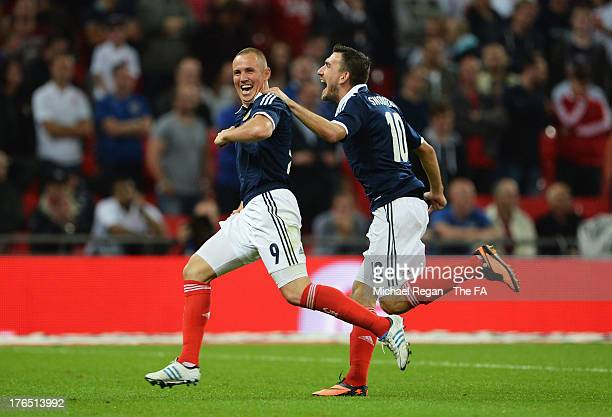 Kenny Miller of Scotland celebrates scoring his side's second goal during the International Friendly match between England and Scotland at Wembley...