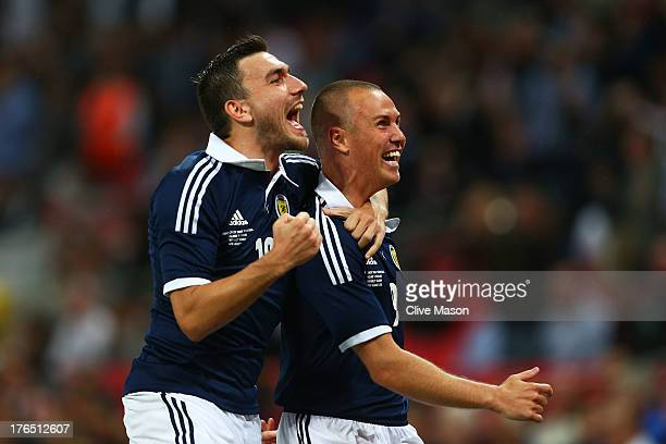 Kenny Miller of Scotland celebrates with teammate Robert Snodgrass of Scotland after scoring a goal during the International Friendly match between...