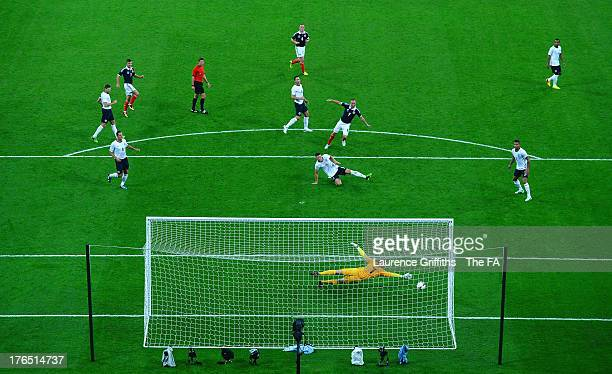 Kenny Miller of Scotland scores his side's second goal past Joe Hart of England during the International Friendly match between England and Scotland...