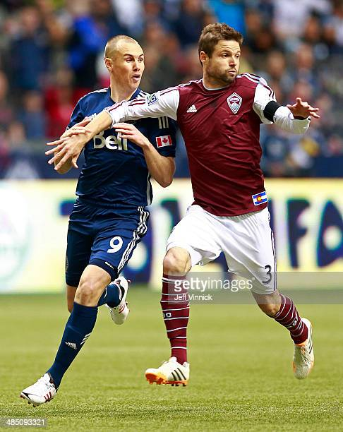 Kenny Miller of the Vancouver Whitecaps FC and Drew Moor of the Colorado Rapids during their MLS game April 5 2014 in Vancouver British Columbia...