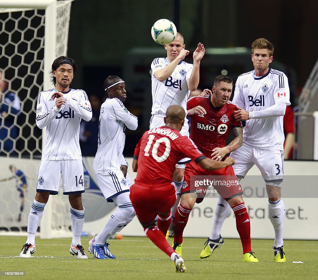 <a gi-track='captionPersonalityLinkClicked' href=/galleries/search?phrase=Kenny+Miller&family=editorial&specificpeople=213276 ng-click='$event.stopPropagation()'>Kenny Miller</a> #9 of the Vancouver Whitecaps FC leaps to play a free kick by <a gi-track='captionPersonalityLinkClicked' href=/galleries/search?phrase=Robert+Earnshaw&family=editorial&specificpeople=208190 ng-click='$event.stopPropagation()'>Robert Earnshaw</a> #10 of the Toronto FC during their MLS game at BC Place March 2, 2013 in Vancouver, British Columbia, Canada.